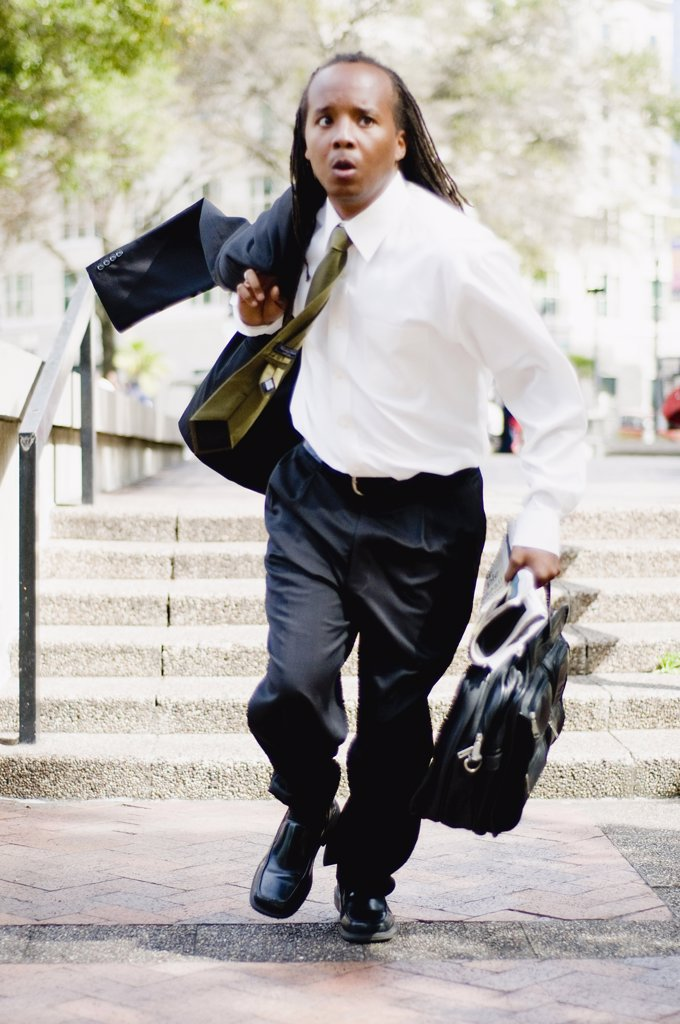 Stock Photo: 4152-233 Businessman running on a street