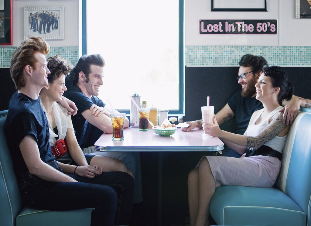 Friends sitting in a restaurant : Stock Photo
