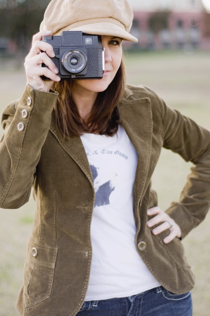 Stock Photo: 4152-257 Close-up of a young woman holding a camera