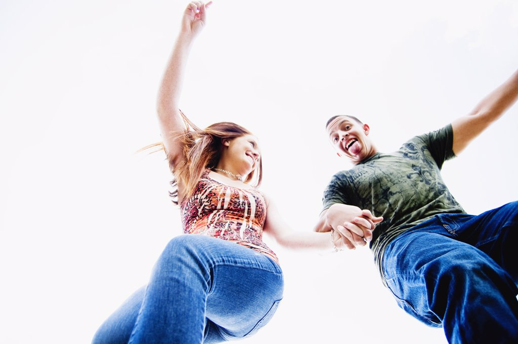 Low angle view of a young couple dancing : Stock Photo