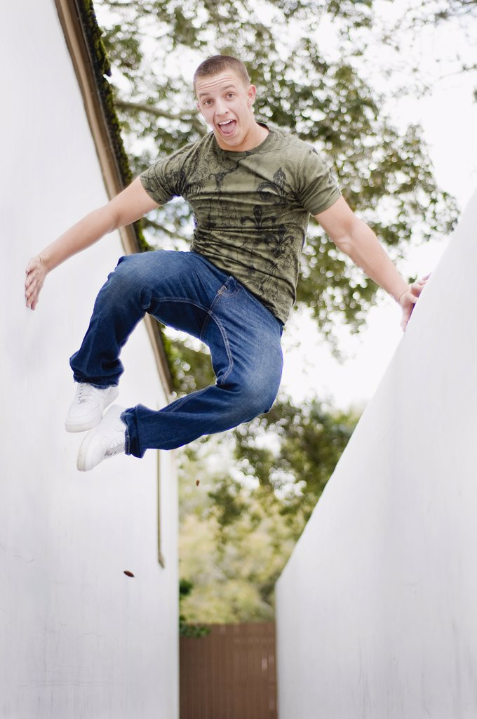 Low angle view of a young man jumping : Stock Photo