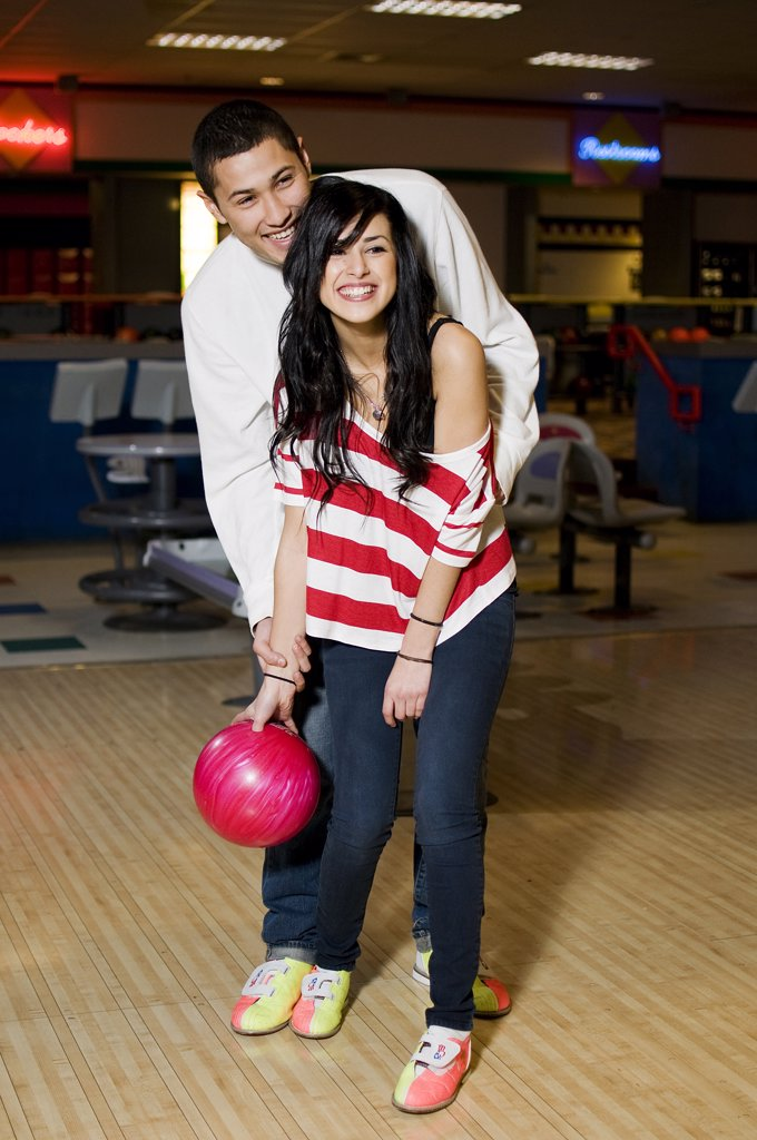 Stock Photo: 4152-292 Young couple playing bowling