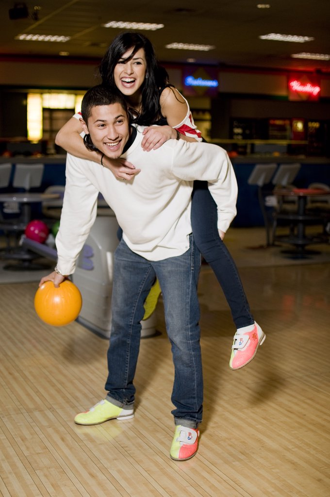 Stock Photo: 4152-293 Young couple playing bowling