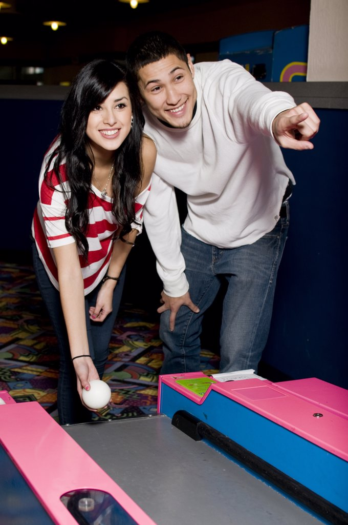 Stock Photo: 4152-294 Young couple playing bowling