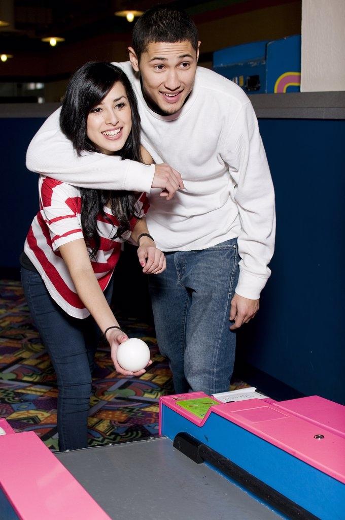 Stock Photo: 4152-295 Young couple playing bowling