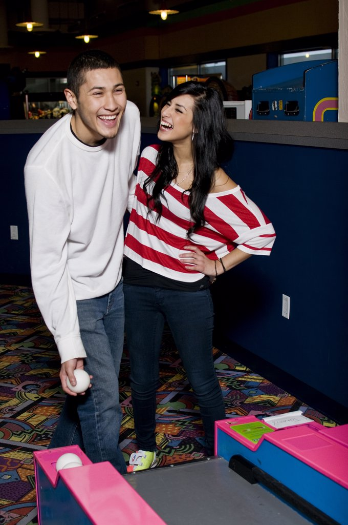 Young couple playing bowling : Stock Photo