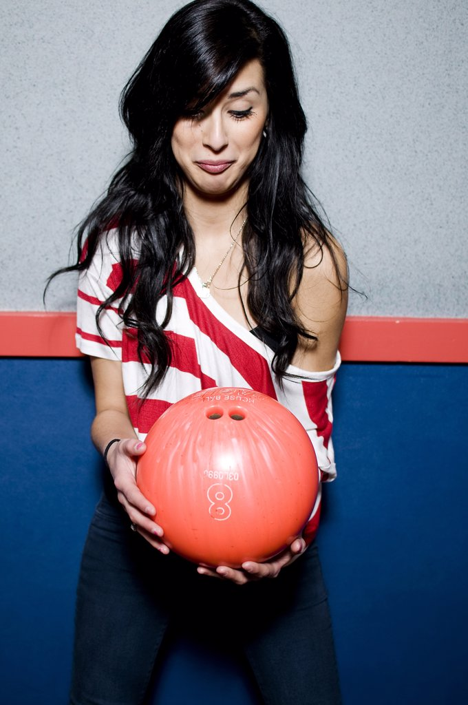 Young woman holding a bowling ball : Stock Photo