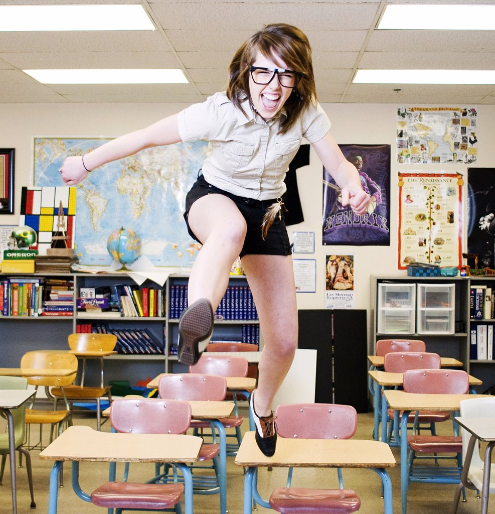 Stock Photo: 4152-317 Excited High School Girl jumping