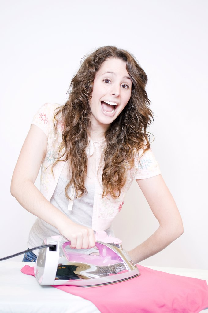Stock Photo: 4152R-298 Young woman ironing
