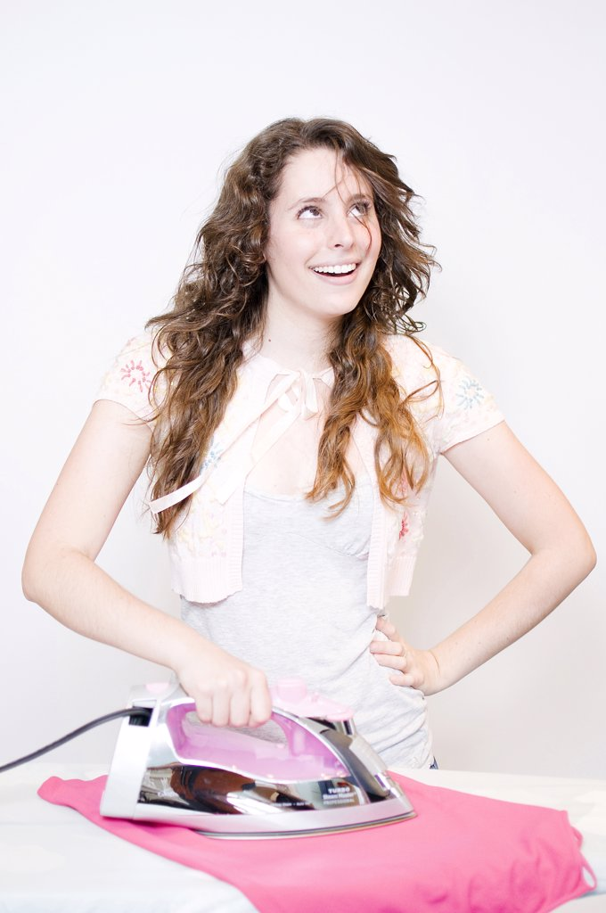Stock Photo: 4152R-299 Young woman ironing