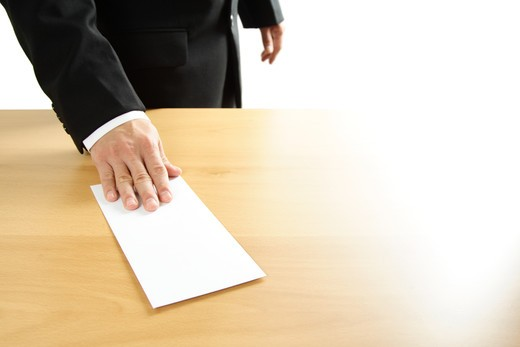 A businessman handing in a blank envelope : Stock Photo