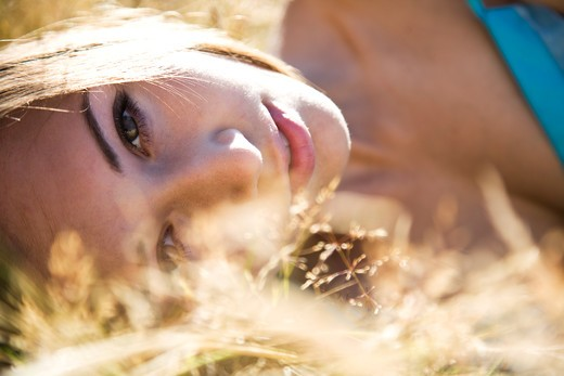 Stock Photo: 4157R-2969 A beautiful caucasian girl lying down on the grass