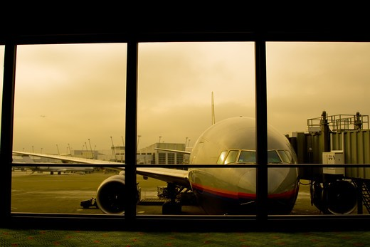 A shot of a parked airplane in the airport : Stock Photo
