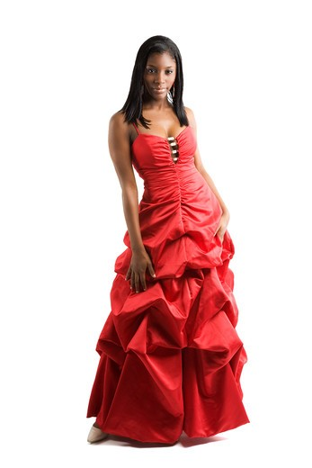 A shot of a african american teenage girl in a prom dress : Stock Photo