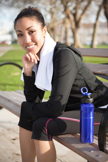 Stock Photo: 4157R-533 A beautiful black woman sitting on a park bench after exercise