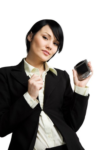 A shot of a smiling businesswoman working on her PDA : Stock Photo