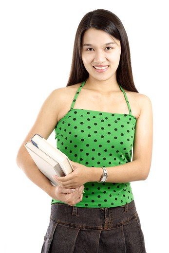 A pretty college student carrying books (isolated white) : Stock Photo