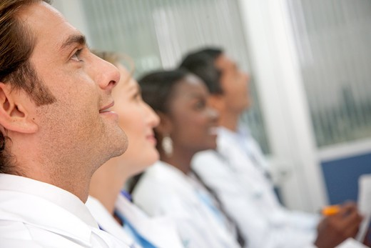 doctors in a hospital having a meeting : Stock Photo