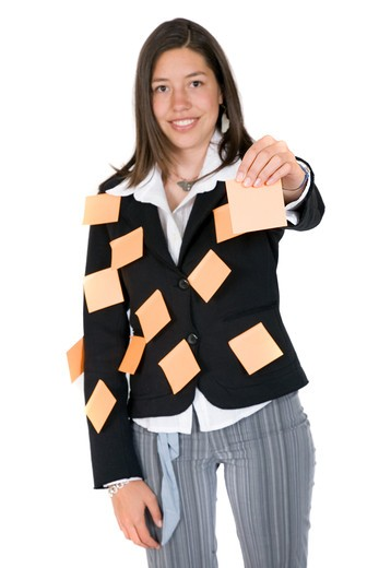 business woman holding a post it up waiting for you to give her a task - over white : Stock Photo