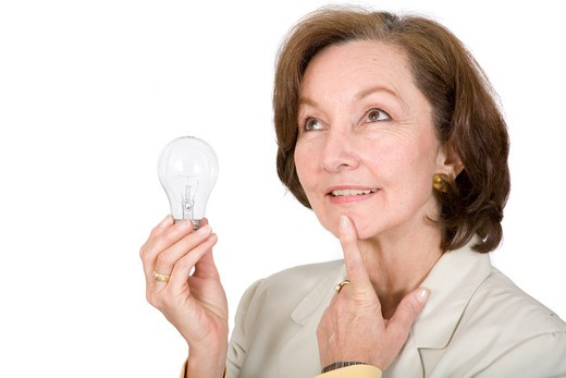 business woman thinking of ideas over a white background : Stock Photo