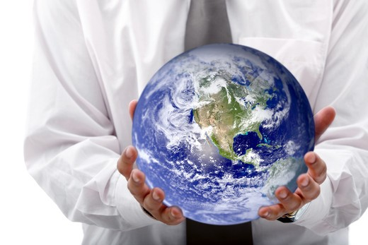 Stock Photo: 4158R-21834 Business woman holding globe isolated over a white background