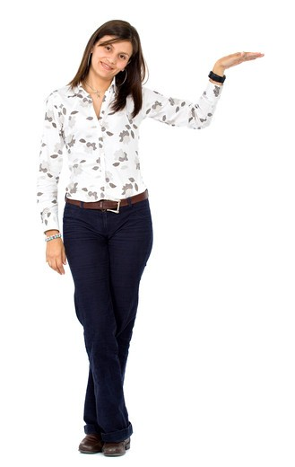 Stock Photo: 4158R-22768 casual woman smiling displaying something isolated over a white background