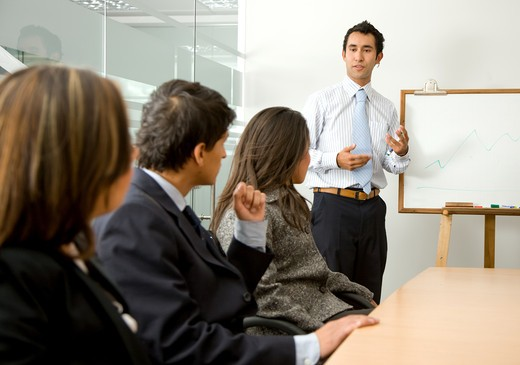 Stock Photo: 4158R-23345 business man doing a presentation in an office
