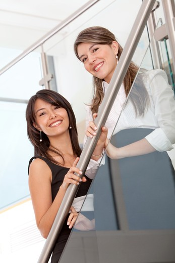 Stock Photo: 4158R-23715 Beautiful business women at the office smiling