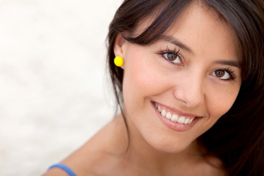 Stock Photo: 4158R-2623 Portrait of a beautiful woman indoors smiling