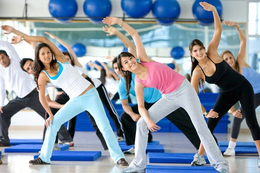 group of gym people in an aerobics class : Stock Photo