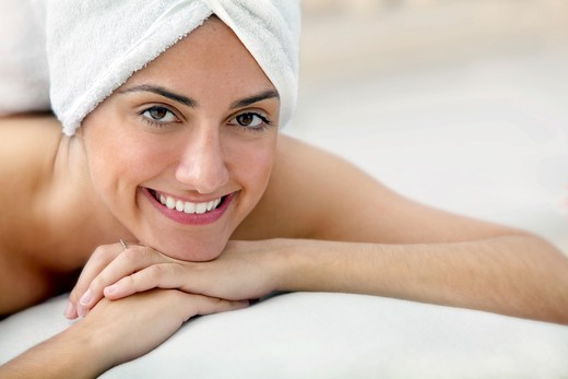 Beauty portrait of a woman with a towel on her head : Stock Photo