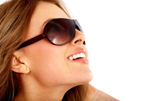 Stock Photo: 4158R-9343 fashion or casual woman portrait wearing sunglasses giving a big smile - isolated over a white background
