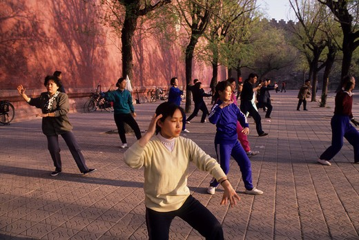 Stock Photo: 4163-10201 CHINA, BEIJING, PEOPLE DOING TAI CHI AT WALL OF FORBIDDEN CITY