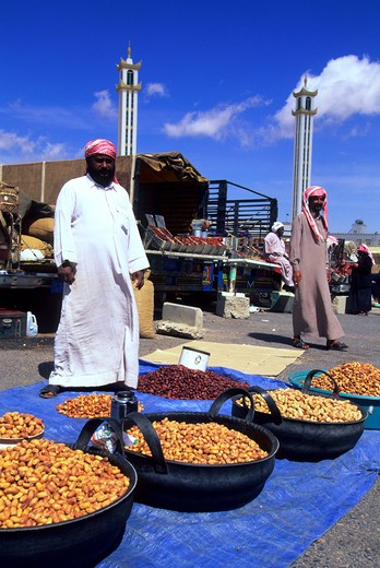 Stock Photo: 4163-10980 SAUDI ARABIA, NEAR ABHA, AL WADIJAN, FRIDAY MARKET, MAN SELLING DATES