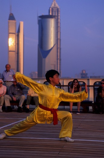 CHINA, SHANGHAI, MS CLIPPER ODYSSEY, YOUNG BOY PREFORMING MARTIAL ARTS : Stock Photo