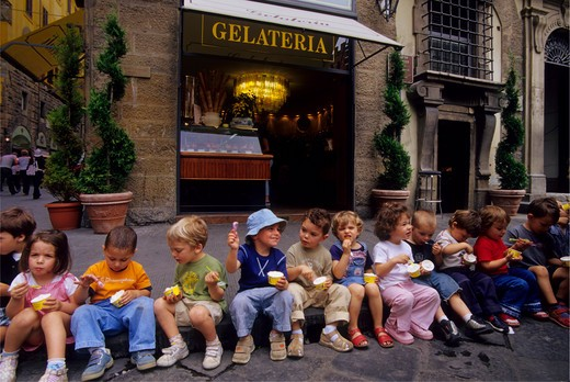 Stock Photo: 4163-14532 ITALY, FLORENCE, STREET SCENE, CHILDREN (KINDERGARTEN) EATING ICE-CREAM