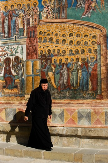 ROMANIA, NEAR SUCEAVA, VORONET MONASTERY (1488), THE LAST JUDGMENT, WESTERN WALL, NUN : Stock Photo