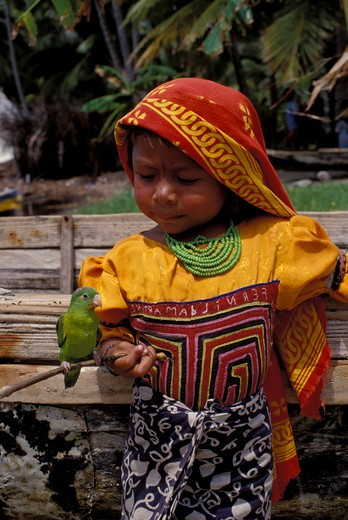 Stock Photo: 4163-17854 PANAMA, SAN BLAS ISLANDS, ACUATUPU ISLAND, KUNA INDIAN GIRL WITH PET PARROT