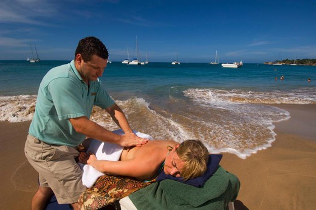 GRENADINES, MAYREAU ISLAND, BEACH, CRUISE SHIP WIND SURF, MASSAGE ON BEACH, MODEL RELEASES : Stock Photo