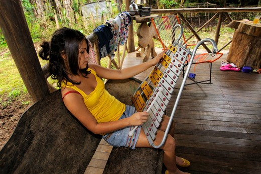 Stock Photo: 4163-19083 COSTA RICA, NEAR ARENAL, HOME IN SMALL VILLAGE, TEENAGE GIRL PLAYING XYLOPHONE