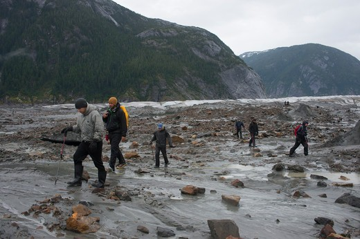 Hikers at Baird Glacier in Scenery Cove, Thomas Bay, Tongass National Forest, Alaska, USA : Stock Photo