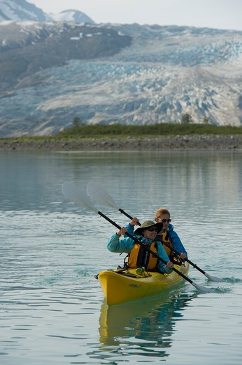 Stock Photo: 4163-21421 People kayaking with Reid Glacier in background, Glacier Bay National Park, Alaska, USA