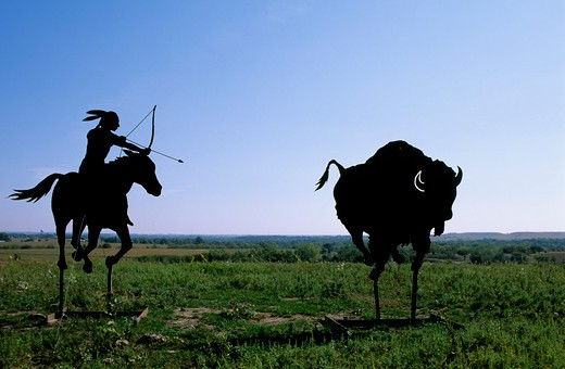 Stock Photo: 4163-3036 USA, KANSAS, FLINT HILLS, NEAR COUNCIL GROVE, METAL SCULPTURE ON HILLTOP, INDIAN HUNTING BUFFALO