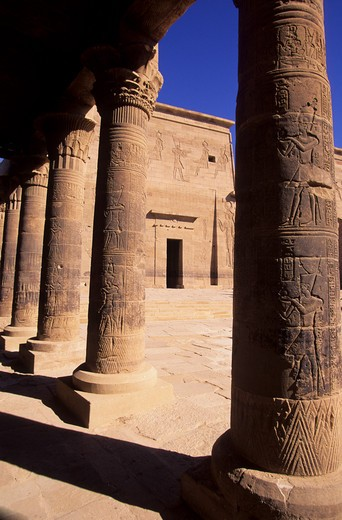 EGYPT, ASWAN, NILE RIVER, AGILKIA ISLAND, PHILAE, WEST COLONNADE VIEW OF FIRST PYLON : Stock Photo