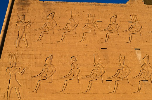 Stock Photo: 4163-7303 EGYPT, NILE RIVER, EDFU, TEMPLE OF HORUS, FIRST PYLON WITH RELIEF CARVINGS, DETAIL
