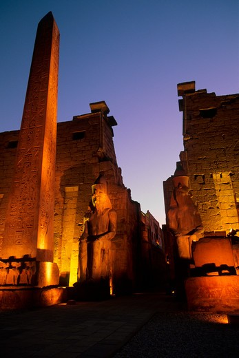 Stock Photo: 4163-7352 EGYPT, NILE RIVER, LUXOR, TEMPLE OF LUXOR, ENTRANCE WITH OBELISK AT NIGHT
