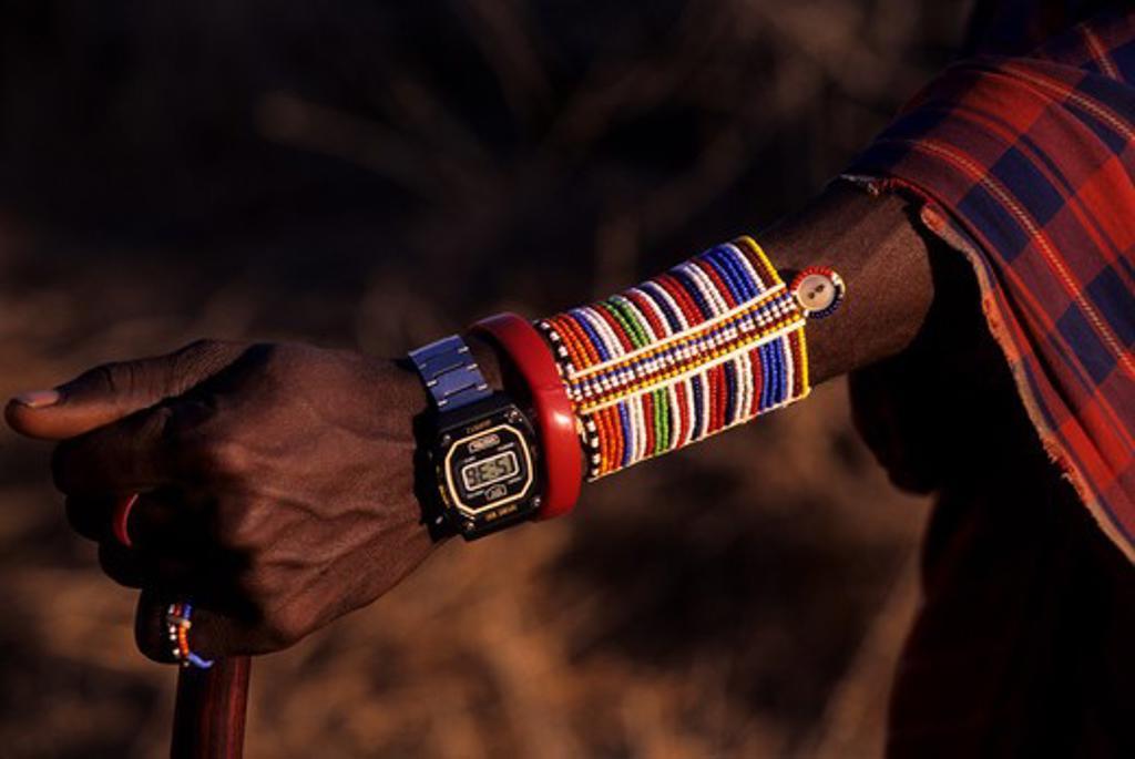 KENYA, AMBOSELI, MASAI MAN, CLOSE-UP OF ARM JEWELERY WITH MODERN WATCH : Stock Photo