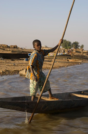 Stock Photo: 4163-8377 MALI, NEAR MOPTI, BANI RIVER, BOY IN PIROGUE (CANOE)