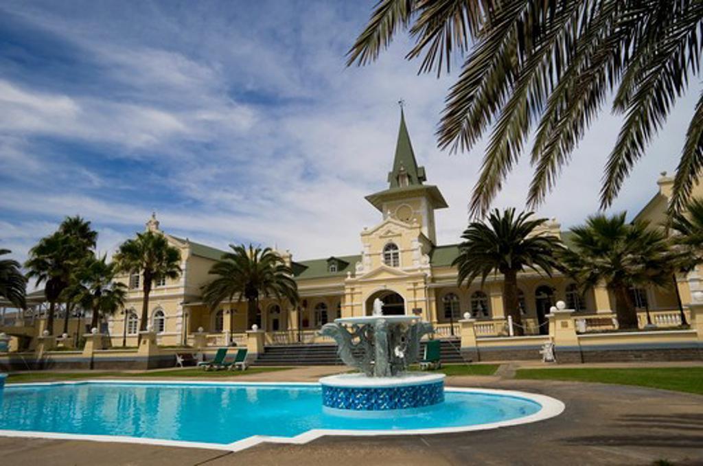 Stock Photo: 4163-8554 NAMIBIA, SWAKOPMUND, SWAKOPMUND HOTEL, COLONIAL VICTORIAN-STYLE, FORMER RAILWAY STATION, SWIMMING POOL