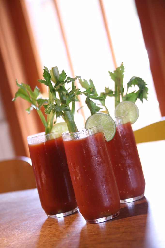 Stock Photo: 4165R-1470 Three Bloody Mary Cocktail Drinks With High Depth of Field